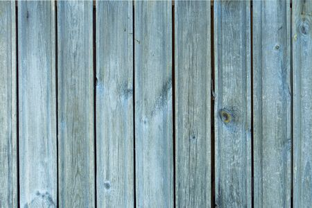 Light blue vertical boards. Textural background. Front view.
