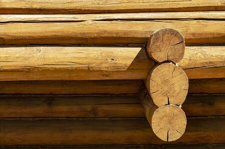 A fragment of a wooden log house made of logs, buildings. Front view Stok Fotoğraf