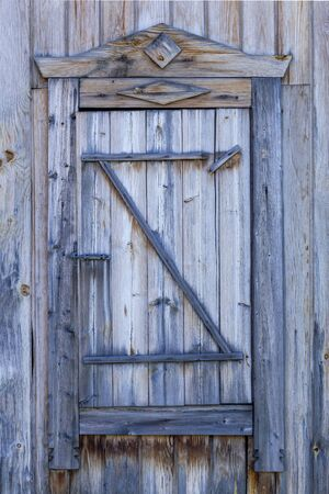 Spare wooden door in an old wooden house. Front view. Stok Fotoğraf - 131261272