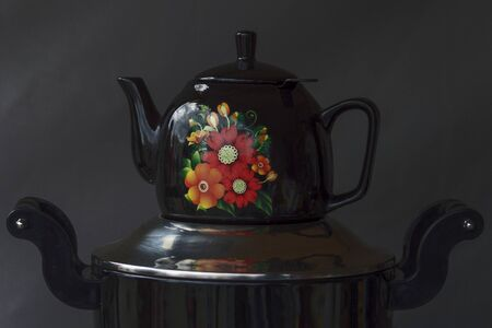 Nickel-plated samovar with a black teapot on top. Still life. Shot in a low key. Stok Fotoğraf