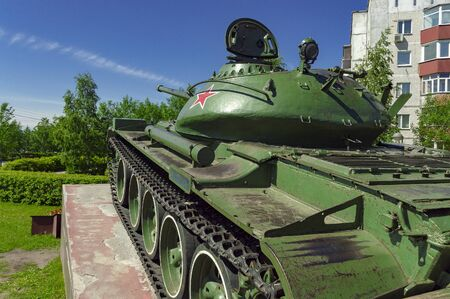 Soviet medium tank in a green color. Monument. Rear side view.