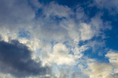 Clouds gray on a blue sky and white clouds. Storm in the fall in Siberia before the first snow. Stok Fotoğraf - 133322339