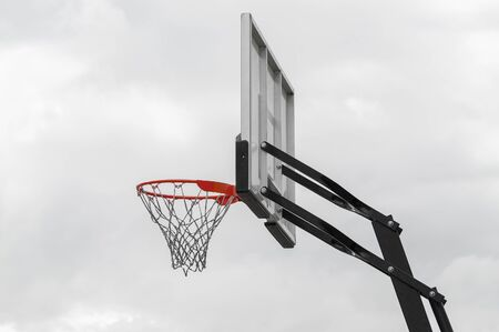 Basketball basket against the sky located outdoors in the street. View from below. Stok Fotoğraf