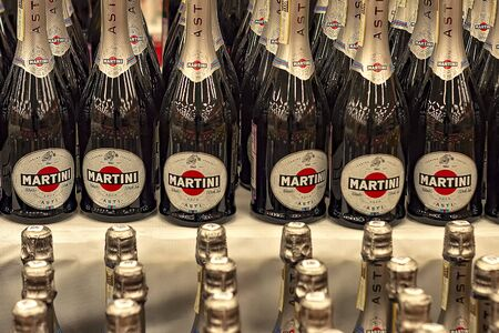 Rows of bottles of Asti Martini bottles in store. Editöryel
