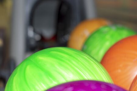 Bowling multicolor balls on the rack. Close up. Stok Fotoğraf