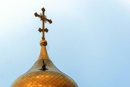 The dome of the golden-colored chapel against the blue sky Stok Fotoğraf