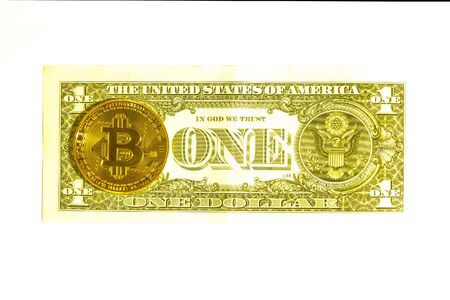 One dollar bill and a bitcoin coin. Isolate the view from above.