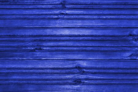 Blue wooden textured background. View from the front