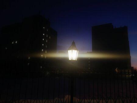 Street lamp in retro style with horizontal flare in night city. Anamorphic optics.
