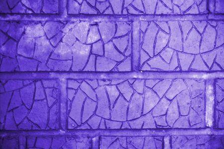 Blue cracked bricks. Wall building