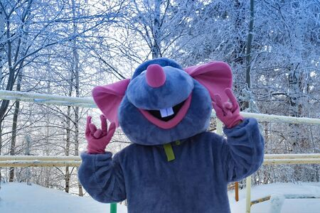 Animator in textile mouse costume. Symbol 2020 year.