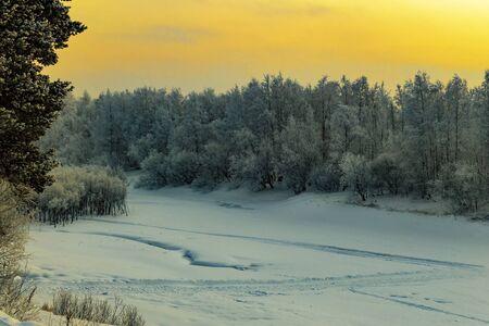 Sunset in winter in Siberia. Nature beautiful.