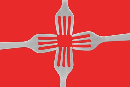 four plastic white forks on a red background Stok Fotoğraf