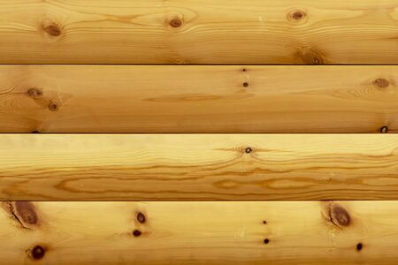 Yellow wooden background from boards. Front view