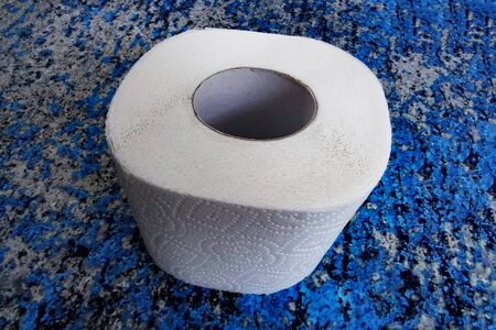 A roll of toilet paper on a blue background Stok Fotoğraf