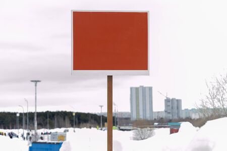 Billboard on background of winter city. Copy space. Front view