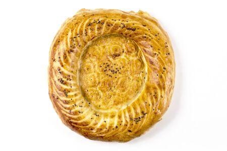 Uzbek flatbread. Isolate on a white background. Top view.