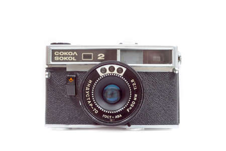 Old film camera ZENIT on white background. Front view. Editöryel
