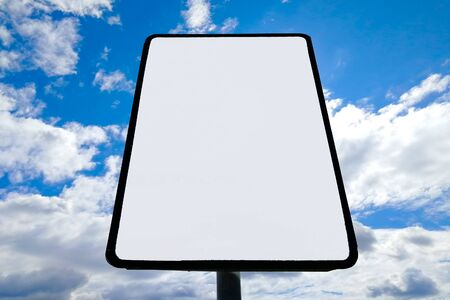road sign against clouds and sun. City Stok Fotoğraf