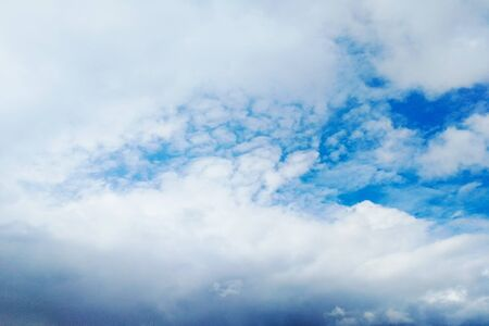 View from below. Blue sky with white clouds.