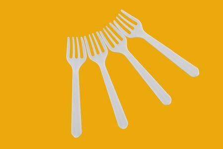 four plastic white forks on background Stok Fotoğraf