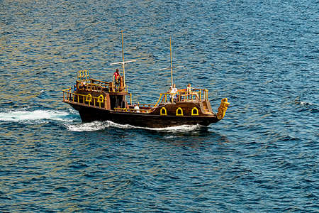 Boat in the form of galleys on black sea