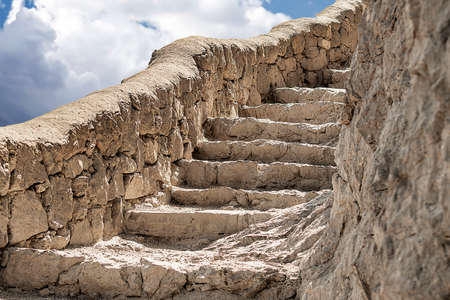 Stone staircase on the rock of the mountain.