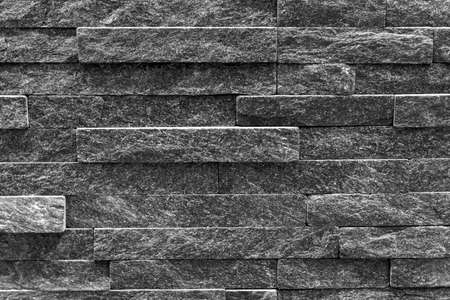 Gray Background is made of artificial stone. Side view, indoors horizontal shot. Stock Photo