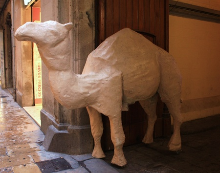 The wooden camel in the shop photo