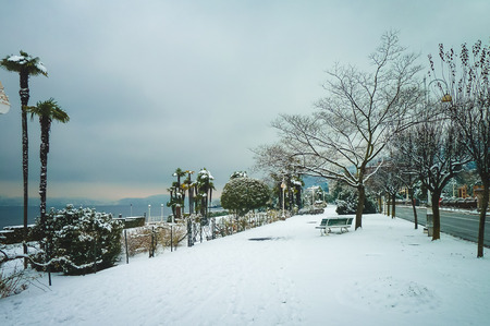Embankment covered with snow. Nice place in Italy for walking.