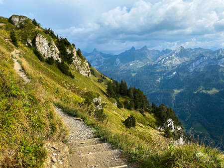 Hiking path with stairs in Swiss Alps Standard-Bild