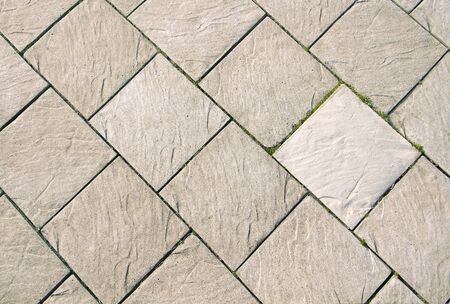 Grey square tiles. Paved footpath. Abstract background