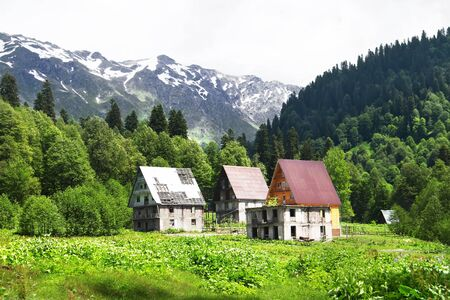 Old abandoned houses in Auadhara. Spring mountain landscape. Caucasus Mountains, Republic of Abkhazia.