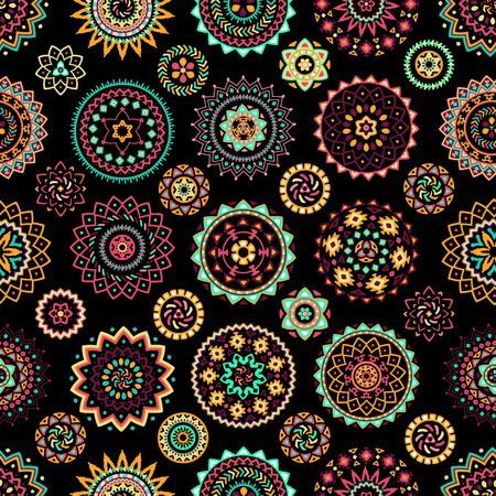 Seamless pattern of bright colorful geometric round ethnic decorative elements. Vector mandala background with bohemian, Oriental, Indian, Arabic, Aztec motifs.
