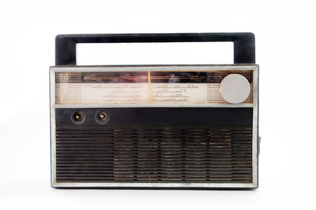 transistor: Old transistor radio isolated on white .