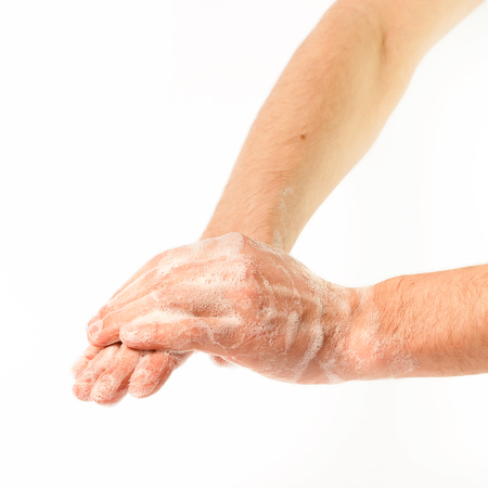 Hands in the foam on white background (isolated)