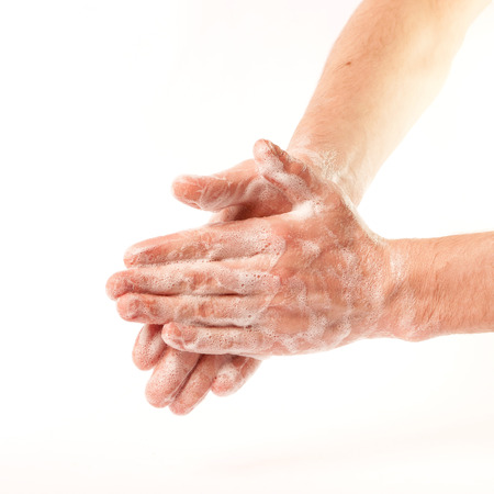 male hand: Hands in the foam on white background (isolated)