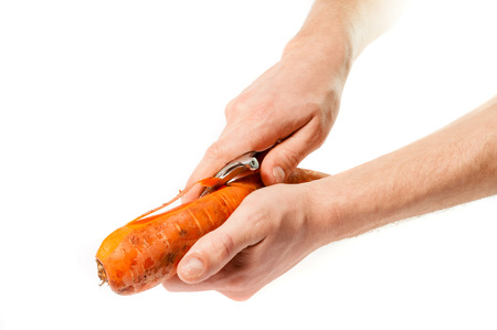 cleanse: Hands carrots cleanse the skin with a knife .