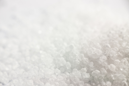 citric acid: White citric acid crystals close up with a blurred background