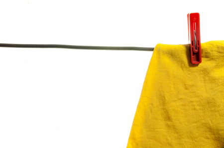 clothespeg: ?????????? Clothes drying on a rope, isolated on white background .