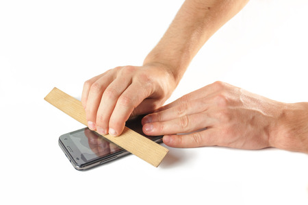 protective: Mens hands are fixed on the phone screen protective film .