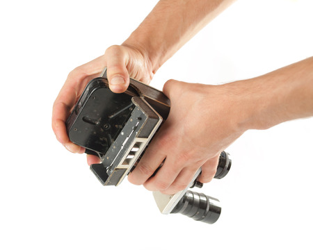 videocassette: Male hands taking out a tape from an old camcorder .