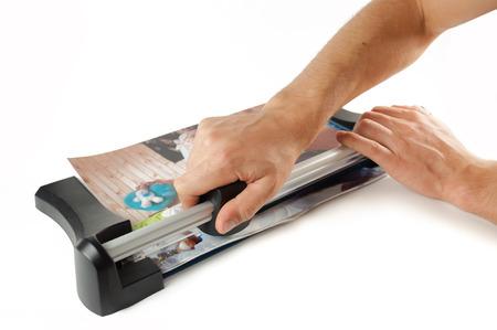 Mans hand cut paper cutter manual .