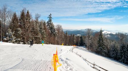 Ski piste in the resort of Bukovel in the Carpathians .