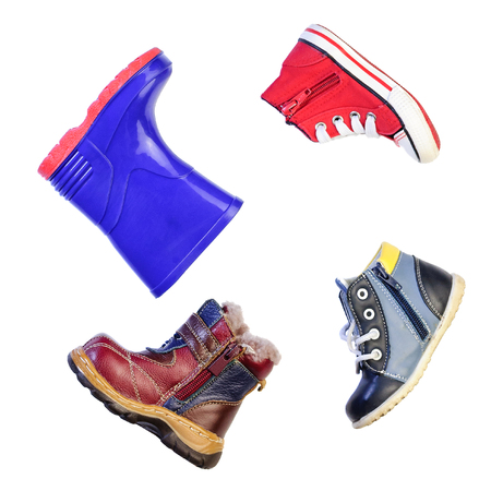 many babies: Childrens shoes for different weather and time of year . Stock Photo