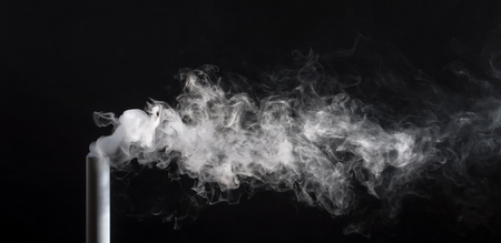 Smoke from a pipe on a black background .