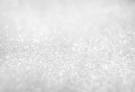 Abstract of Bright and sparkling bokeh background. silver and diamond dust bokeh blurred lighting from glitter texture.