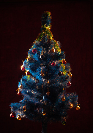 Christmas tree on a dark background .