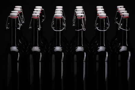 Wine bottles on black background. Isolated black background. Stock Photo