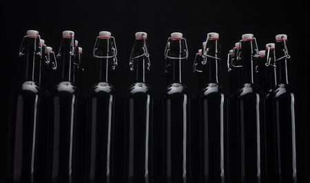 Wine bottles on black background . Isolated black background.